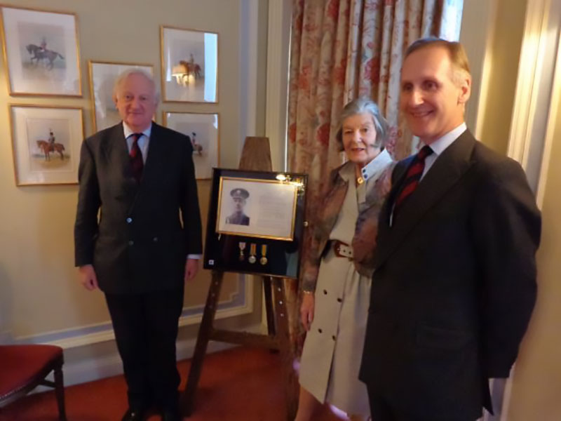 The Lieutenant Colonel with Randall Nicol and Mrs Linnet Waghorn – with the Albert Medal and citation on display behind them.