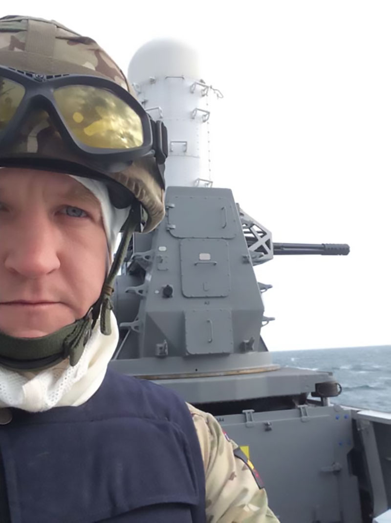 Captain Dalzel-Job waiting for the Phalanx Close-In Weapon System (CIWS) to fire aboard HMS Duncan.